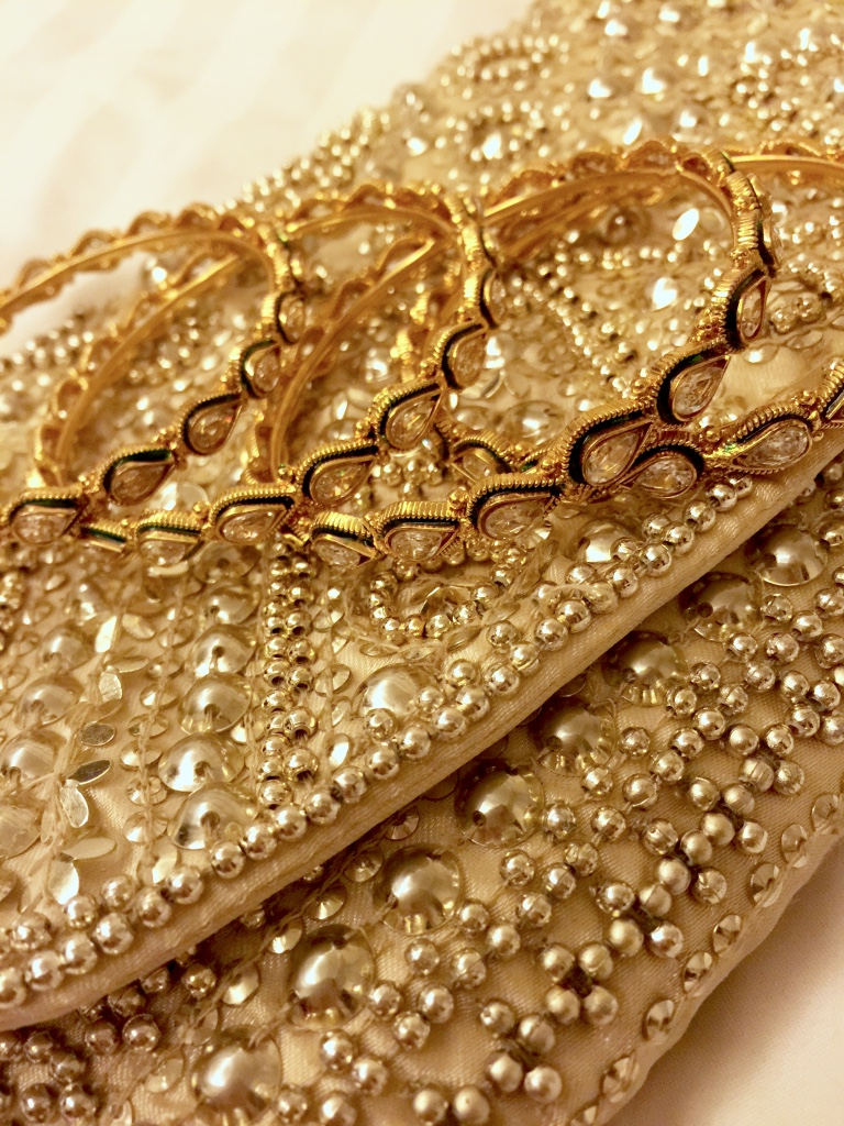 Bangles and beaded clutch