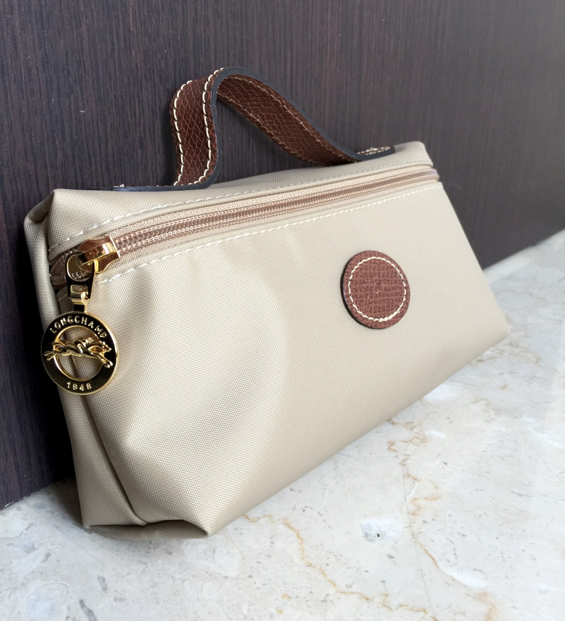Longchamp cosmetic bag beige
