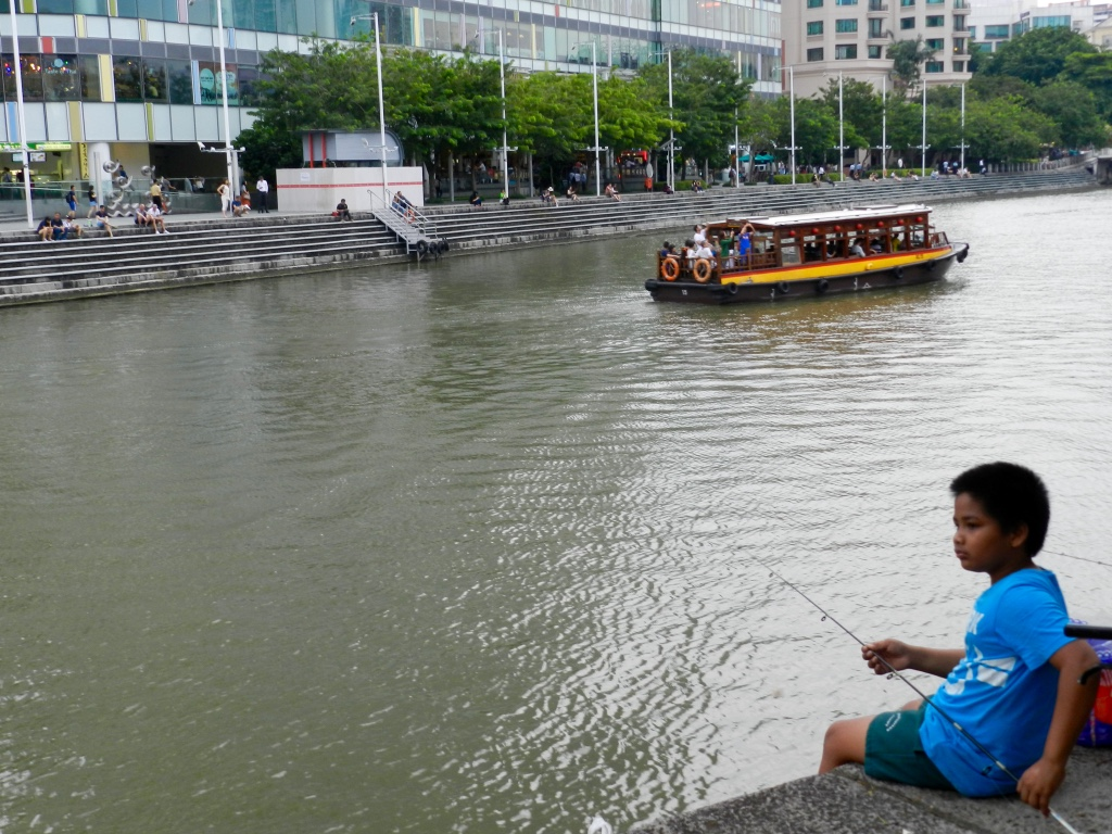 Boy fishing in Clarke Quay